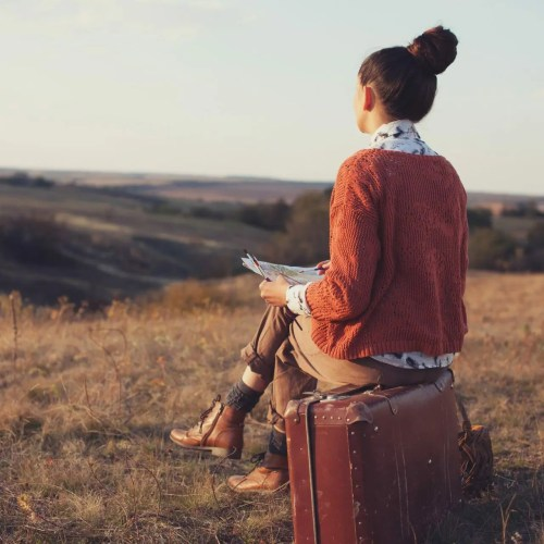 artist on suitcase, how travel benefits artists