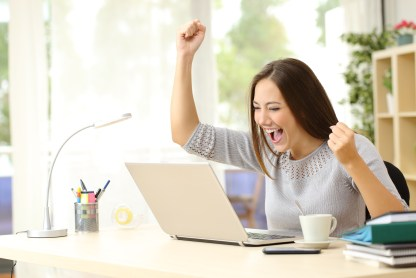 Euphoric winner winning at home office desk