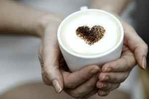 foamy coffee with chocolate heart for creatives