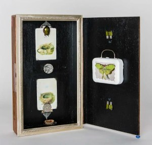 """Soul RetrivaI II 2016, by Thea Fiore-Bloom. Assemblage/mixed media: vintage cigar box, crystal, spark plugs, foreign coins, beetle, Barbi suitcase, 4''x 5''x 9' closed'. Copyright © 2016 Thea Fiore-Bloom. Used by permission of the artist. <a href=""""https://www.etsy.com/shop/EnchantedMuseum"""">Click here to visit my Etsy Shop.</a>"""