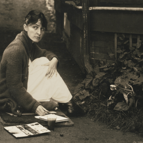 """Georgia O'Keeffe painting outside Stieglitz family home in Lake George. 1918. Photo by Alfred Stieglitz."
