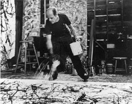 Hans Nemuth photo of Jackson Pollock ( who had a creative rivalry with de Kooning's) painting on his studio floor.