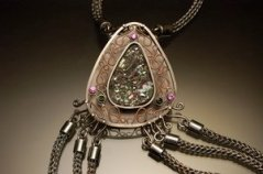 "Photo of artist and veteran Lindsay Zike's piece entitled ""Lavinia's Body Chain ""(detail), 2014, by <a href=""http://www.zikestudios.com"">Lindsay Zike</a>. Sterling Silver, Fine Silver, Copper, Tourmaline, Druzy Crystal, 2.25""x1.75"" (pendant) 149"" (chain). © 2014 James Zike."