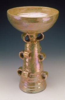 "Beatrice Wood's ""Luster Chalice"" ceramic vessel in tangerine"