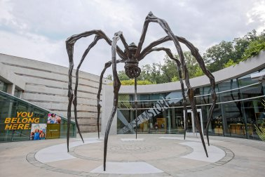 """The giant metal spider sculpture by Louise Bourgeoi entitled """"Maman"""" outside Crystal Bridges Museum Stores, Bentonville, Arkansas.Photo by Marc F. Henning, 2015."""