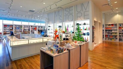 Columbus Museum of Art, Museum store interior photo, light woods and light blue lighting. Columbus, Ohio. DesignGroup Architects. Photo by Andrew Andoniadis, 2015.