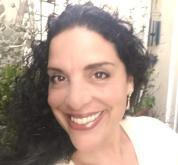 Photo of Thea Fiore-Bloom, PhD. Thea offers the writing coaching for artists packages on this page.