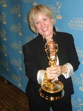 Emmy Award winning executive producer and Charmed Studio subscriber, Gina Rubinstein. Photo of smartphone art marketing video maven Gina with her emmy.