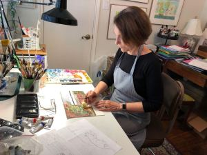Artist Sheryl Perry working on illustrations, for Charmed Studio Blog Topics for Artists post
