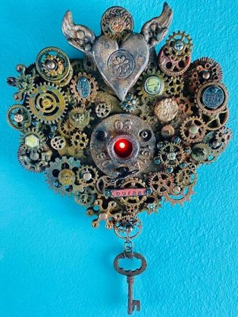 sculpture of a heart out of found objects like keys and watch parts fo art newsletter post