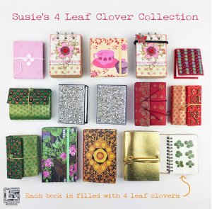 Flat lay of Suzies four leaf clover book collection