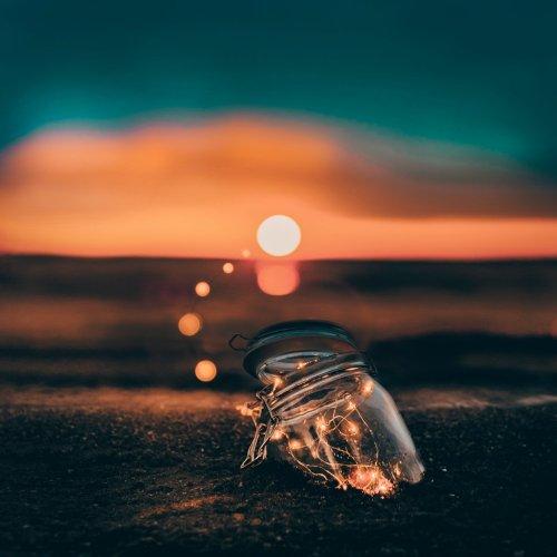 Charmed Studio mason jar on beach for Melissa Zink article