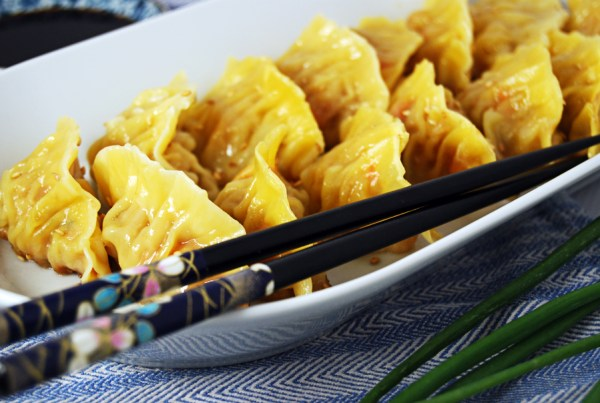 Chicken and Shrimp Potstickers: Chicken thigh and shrimp potstickers featuring beautiful Asian flavors like oyster sauce, soy sauce, carrot, and green onion.