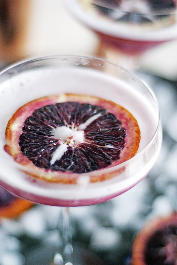 This blood orange vodka martini is the perfect cocktail for the fall, featuring fresh blood orange juice, apricot jam, and vodka.