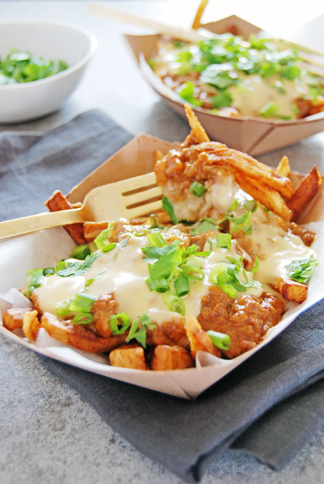 These tasty chorizo chili cheese fries feature a rich chili sauce made from Mexican chorizo and cheddar cheese sauce paired with crispy french fries.