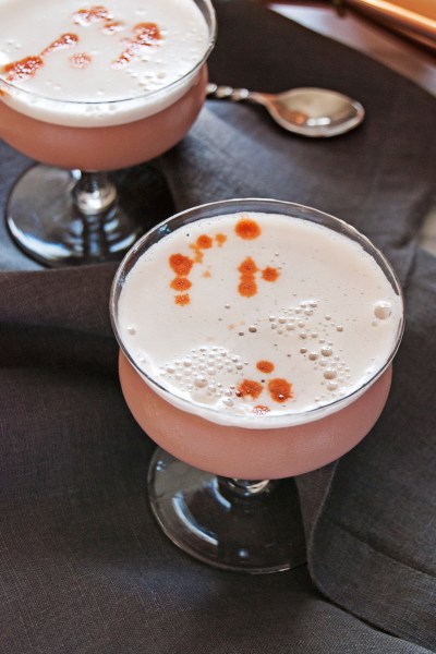 These tasty rum fizz cocktails feature delicious pineapple juice and pomegranate juice and are finished with Angostura bitters.
