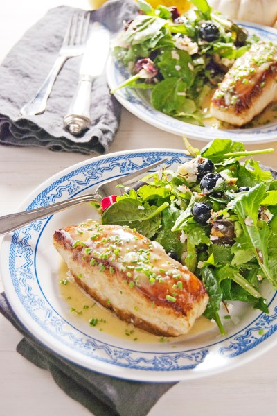 A simple and delicious pan seared sea bass paired with luscious lemon chive beurre blanc.