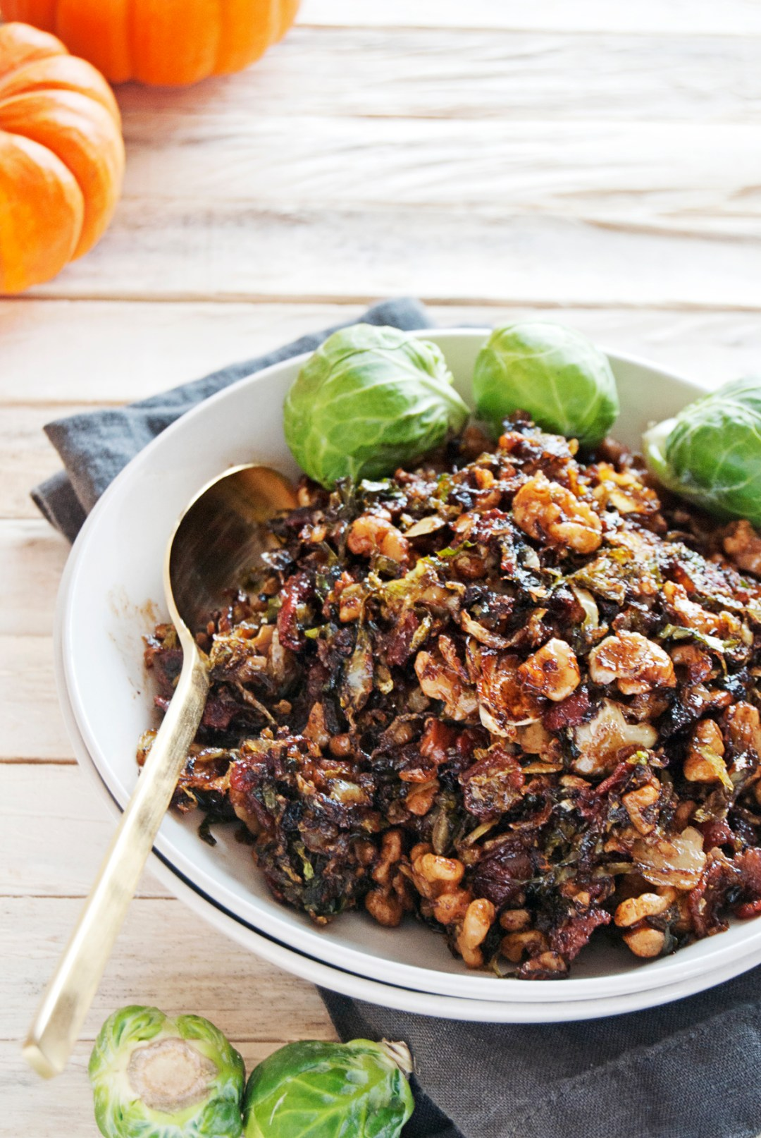 These shredded Brussel sprouts are the perfect flavor-filled side dish this fall, with bacon, walnuts, and balsamic.