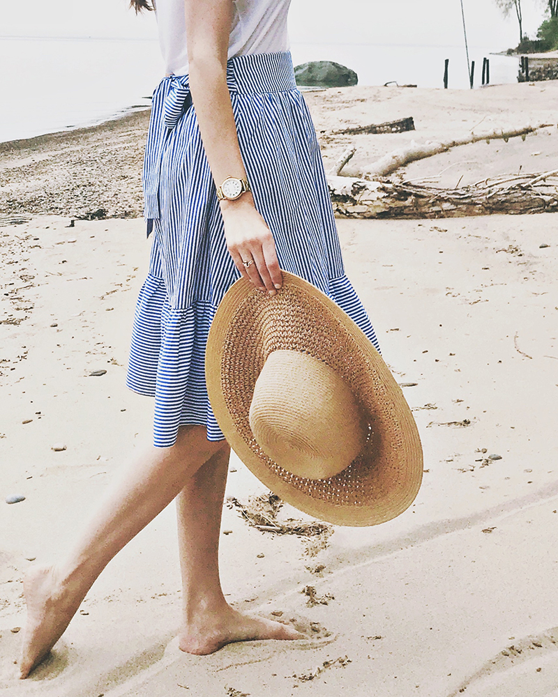 Blue striped J. Crew bow skirt + white Banana Republic t-shirt + straw J. Crew Factory hat + gold Shinola watch