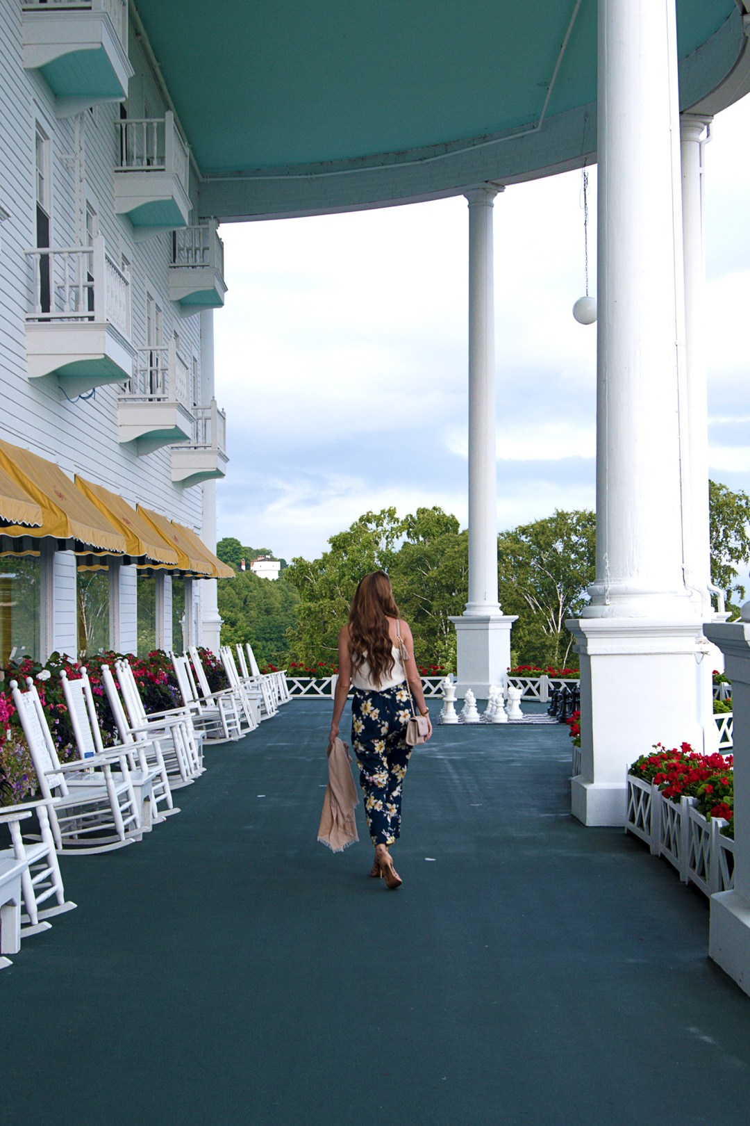 I'm sharing my weekend getaway outfit from our recent trip to Mackinac Island! These floral pants are my new fav, and pair easily with a simple blouse!