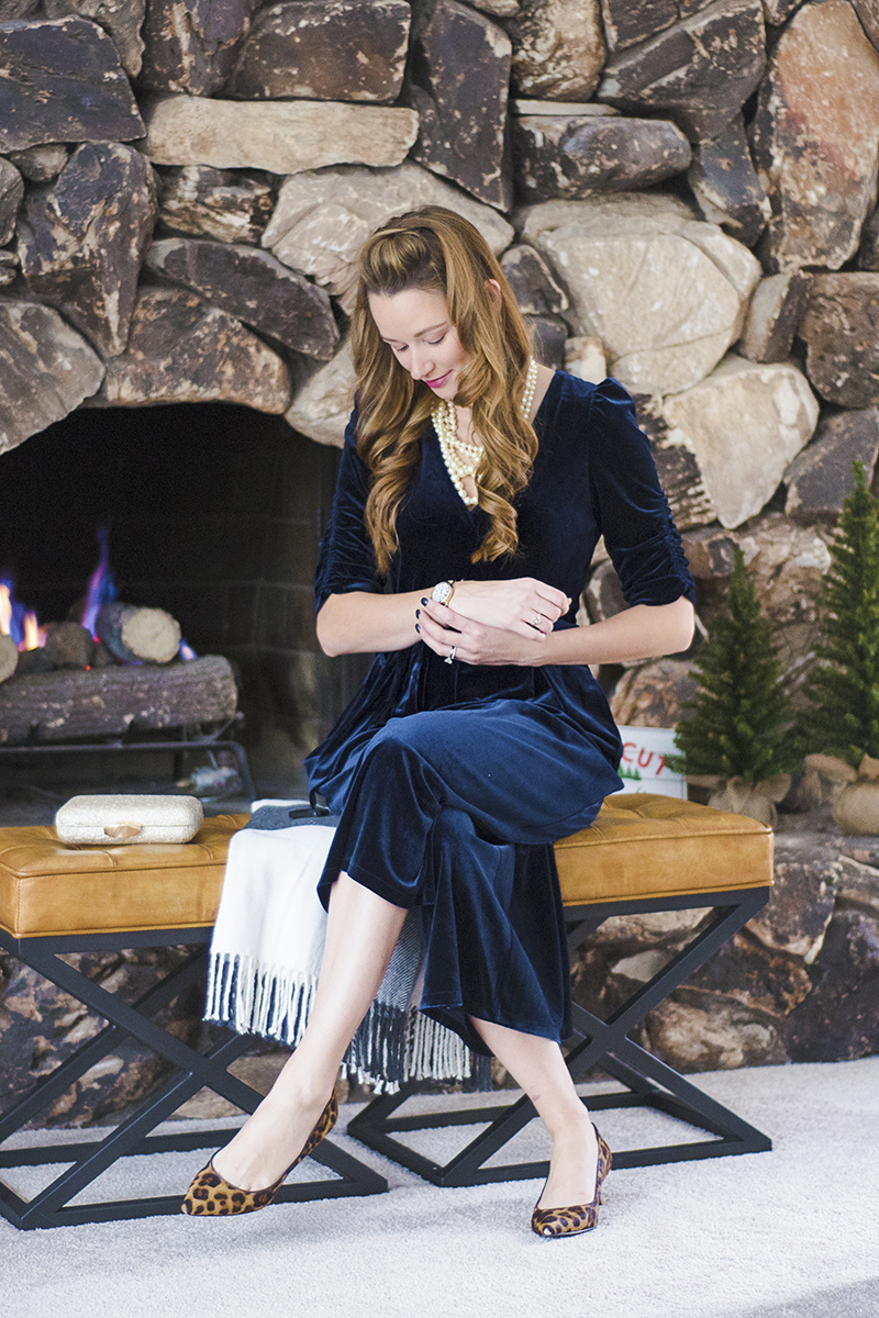 This navy blue velvet jumpsuit will steal the show at any holiday party! It features a tie waist, pockets (my fav!) and perfectly pairs with glitter and pearls!