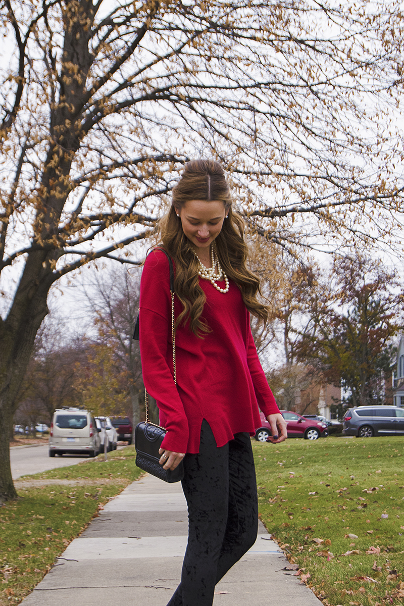 This red cashmere sweater paired with black crushed velvet leggings, leopard print pumps, and some beautiful big curls is the perfect holiday party outfit!