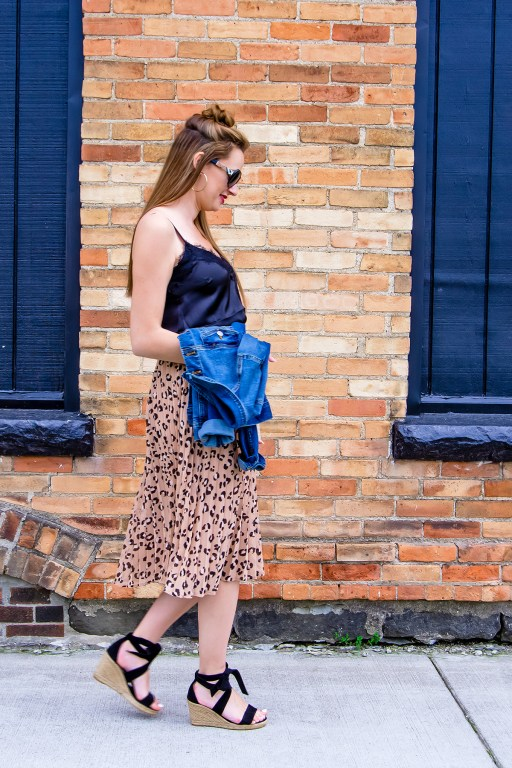 Looking for a cute summer work look? Look no further than this leopard print skirt outfit! Paired with wedges, a black cami and a jean jacket, it's the perfect warm weather look!