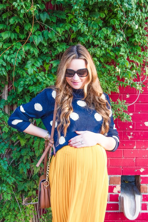This navy polka dot sweater is perfect for fall, and pairs just as perfectly with a cute bright skirt as it does with a pair of jeans!