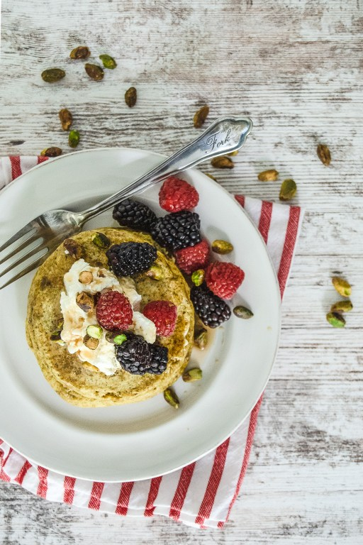 Breakfast gets an upgrade with these pistachio pancakes! Paired with mascarpone cream, macerated berries, and sliced almonds, it's like dessert for breakfast!