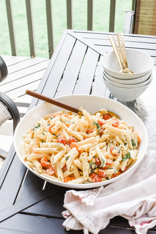 This tomato basil pasta salad will be an instant hit this summer, with corn, goat cheese, and a simple refreshing lemon and Greek yogurt vinaigrette.