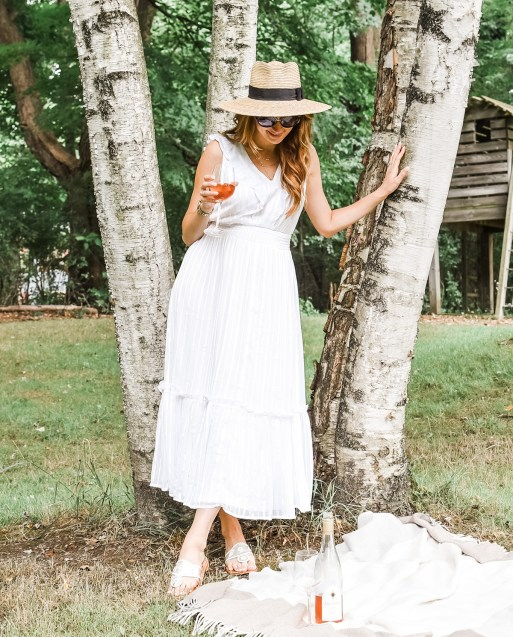 This white summer midi dress is perfection, and fits right in to any chic, late summer wardrobe!