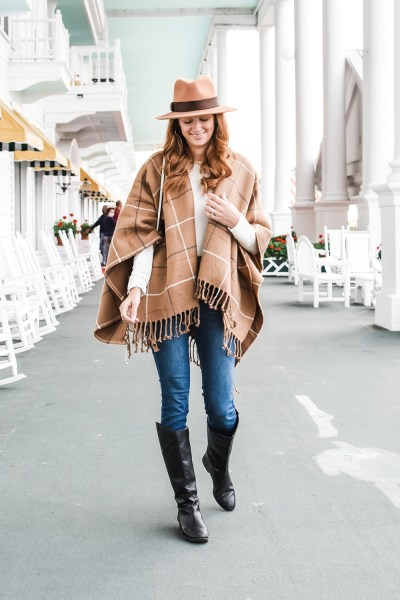This fall plaid poncho look is just perfect for the autumn! I paired it with jeans and some of my favorite boots for a casual fall look here!