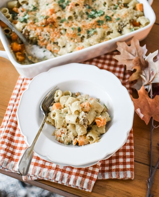 Stews and and soups and hearty bakes! Oh how I love you, fall! I am sharing some delicious comfort food today on the blog with my sweet potato and sausage rigatoni bake!