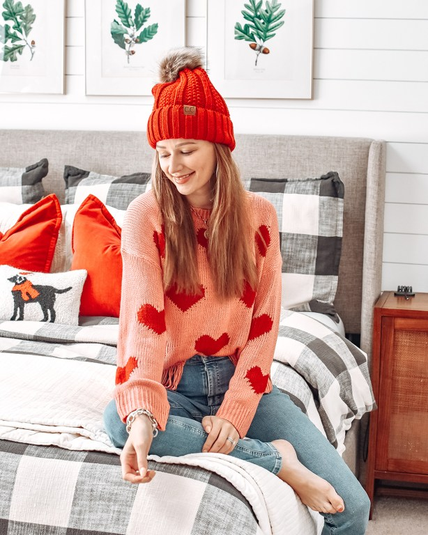 Celebrate Valentine's Day with this cute, cozy, and casual Valentine's Day outfit! Featuring lots of knit hearts paired with casual jeans, this is the perfect look for a celebration at home!