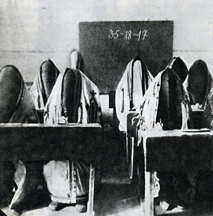 during the first illiteracy campaigns in Tashkent, still wearing their parandzhi in 1921