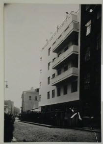 Vladimirov, V. Exterior view of the house-commune for State Insurance (Gosstrakh) employees showing the ground floor boarded up, 21 Malaia Bronnaia Street, Moscow, 1927 or later