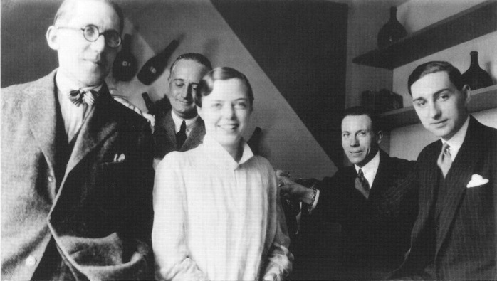 Le Corbusier, Percy Scholefield (Charlotte Perriand's first husband), Charlotte Perriand, George D. Bourgeois, and Jean Fouquet at the Salon d'Automme, Paris, 1927. Photo by Piere Jeanneret.