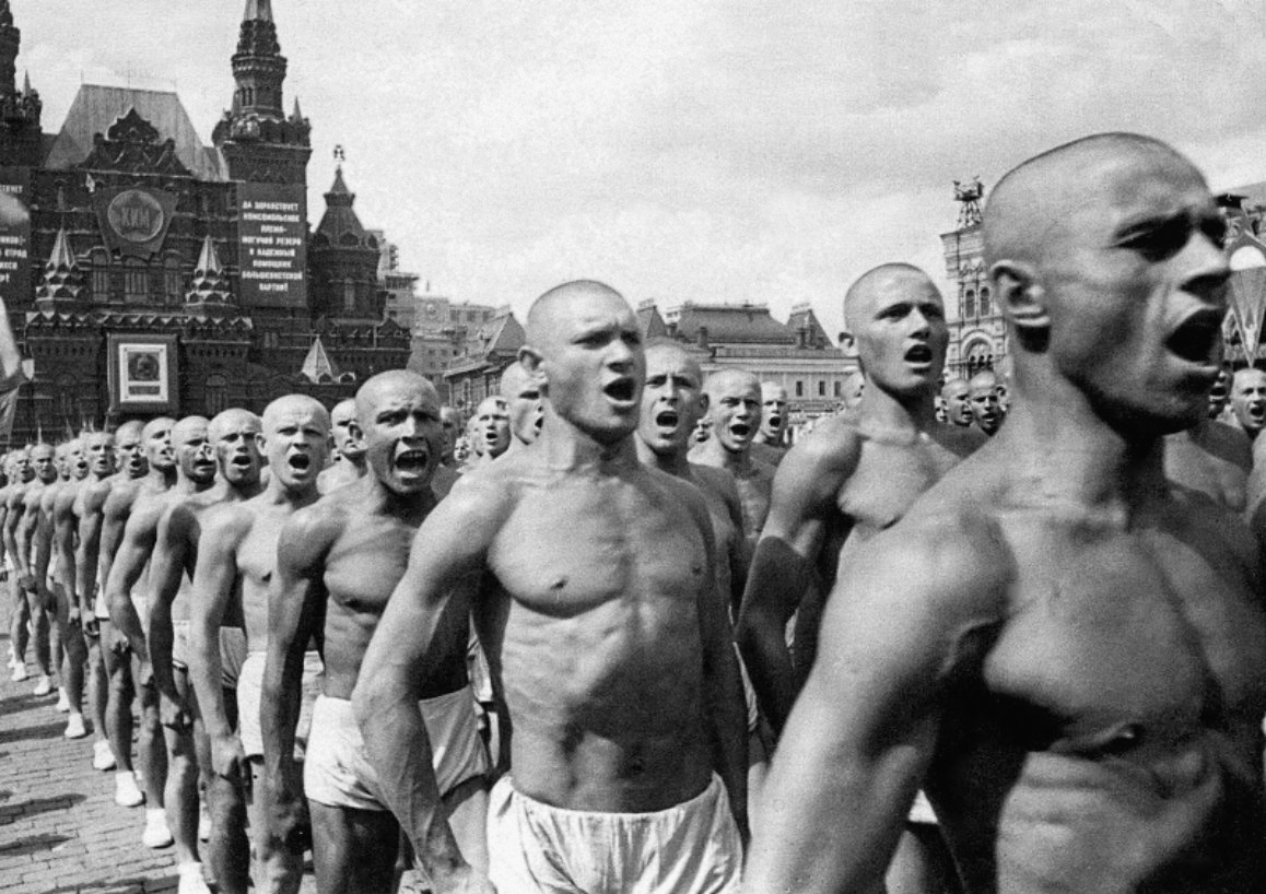 Same-sex sports clubs often served as a site of homoerotic flirtation and socialization. ABOVE: Fizkul'tura parade through Red Square, 1924