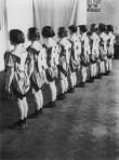 """Varvara Stepanova. Students in sports clothing designed by Stepanova. in performance of An Evening of the Book,. 1924. spelling out """"intermission"""""""