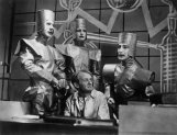 """11 Feb 1938, Haringay, Outer London, London, England, UK --- A scene of a television production of , or Rossum's Universal Robots, by Czech playwright Karel Capek, which introduced the term """"Robot"""" into many of the world's languages. (l to r) Connaught Stanleigh, Derek Bond, Larry Silverstone and front, Evan John --- Image by © BBC/Corbis"""
