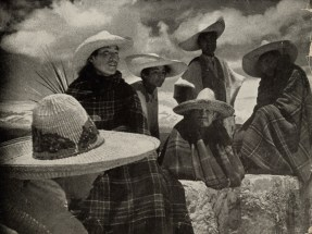 Mexican peasants, watching from a hilltop the passing funeral