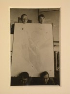 Unknown Portrait of Hannes Meyer, Aryeh Sharon and unidentified students at the Bauhaus in Dessau, Germany, holding a competition drawing by Hannes Meyer and Hans Wittwer for the League of Nations Building in Geneva, Switzerland, between 1927-1929