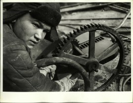 Margaret Bourke-White, Russian steel worker turning gear wheel in a steel mill (1931)