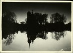 Margaret Bourke-White, Silhouette of Russian orthodox church reflecting off the water of a lake at dusk (1931)