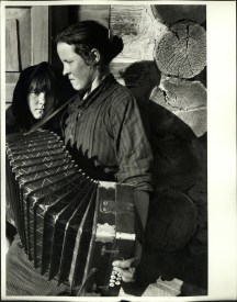 Margaret Bourke-White, Woman playing a Russian button accordian as her young girl looks on (Magnitogorsk, 1931)