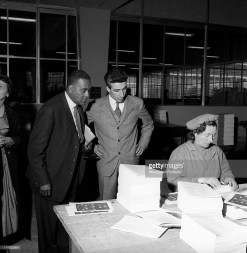 American writer Richard Wright watching a worker working at the Mondadori publishing house new factory. Verona, 1957