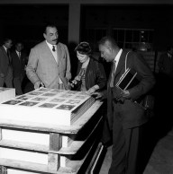 Italian publisher Alberto Mondadori showing to American writer Richard Wright and his wife Ellen Poplar some prints made at the Mondadori publishing house new factory. Verona, 1957