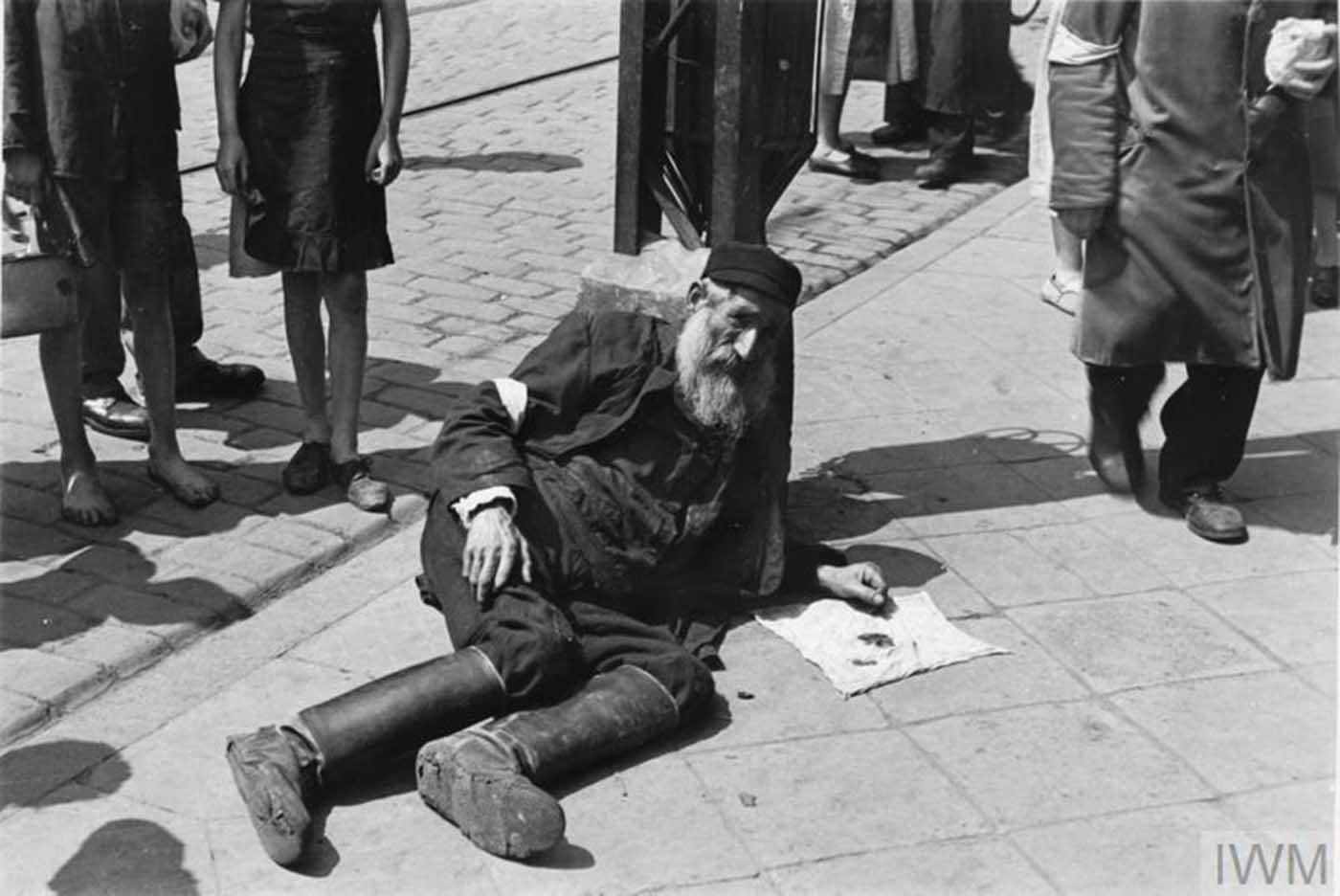 An elderly man lying on the pavement