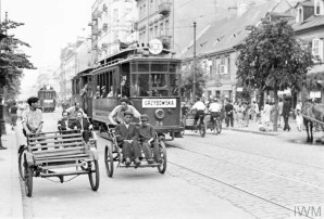 Street rickshaws and a tramcar carrying passengers along Leszno Street in the ghetto, summer 1941