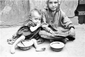 Two children begging for food on the street